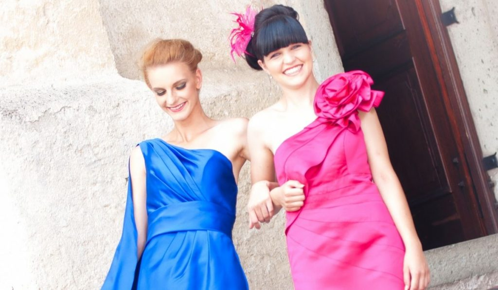 bridesmaids wearing a pink and blue dress outside the church