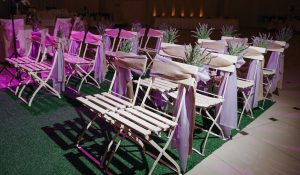 chairs set up for a wedding with Lilac and Lavender ribbons
