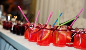 red cocktails in a jar glass for a wedding