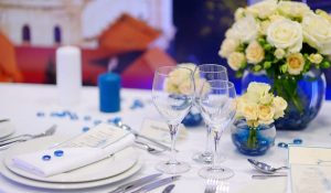 table setting for a wedding with a white and powder blue theme