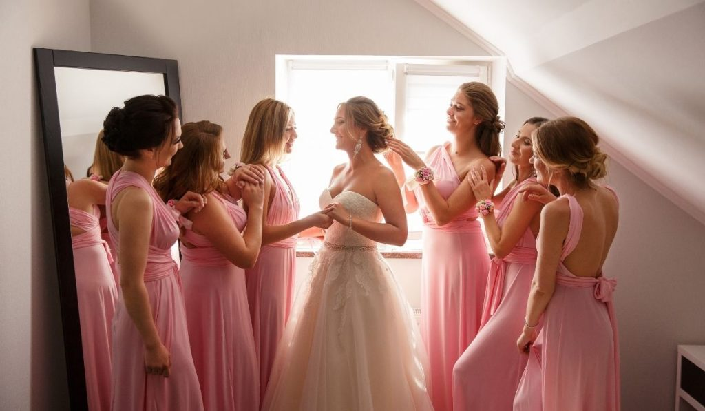 the bride with her bridesmaids in their pink gowns