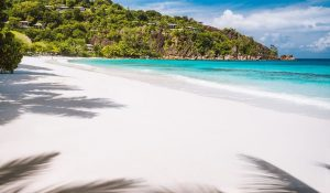 white sand beach and clear blue water at Petite Anse - Mahe Island, Seychelles