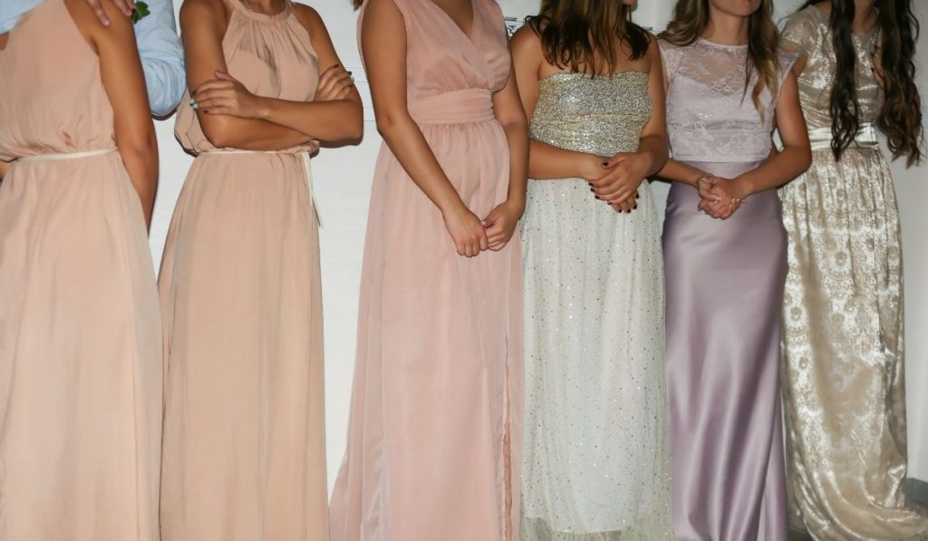 Bridesmaids at Wedding Ceremony With Pastel Colored Dress