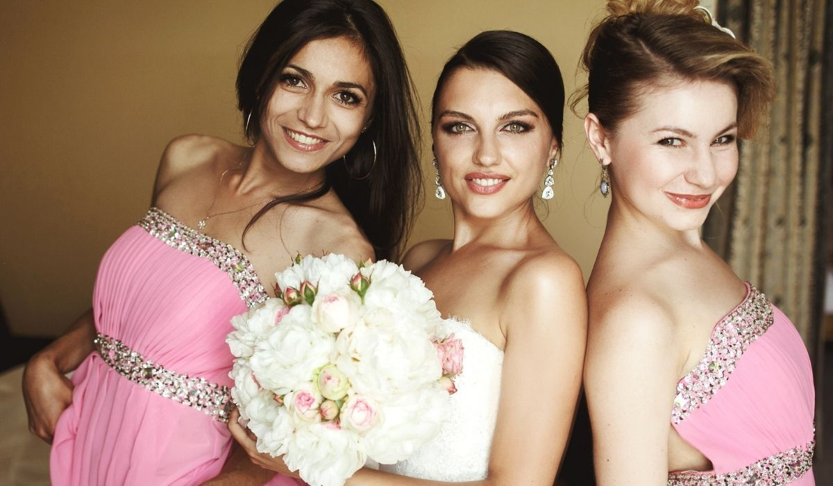 bride-together-with-her-brides-maid-in-pink