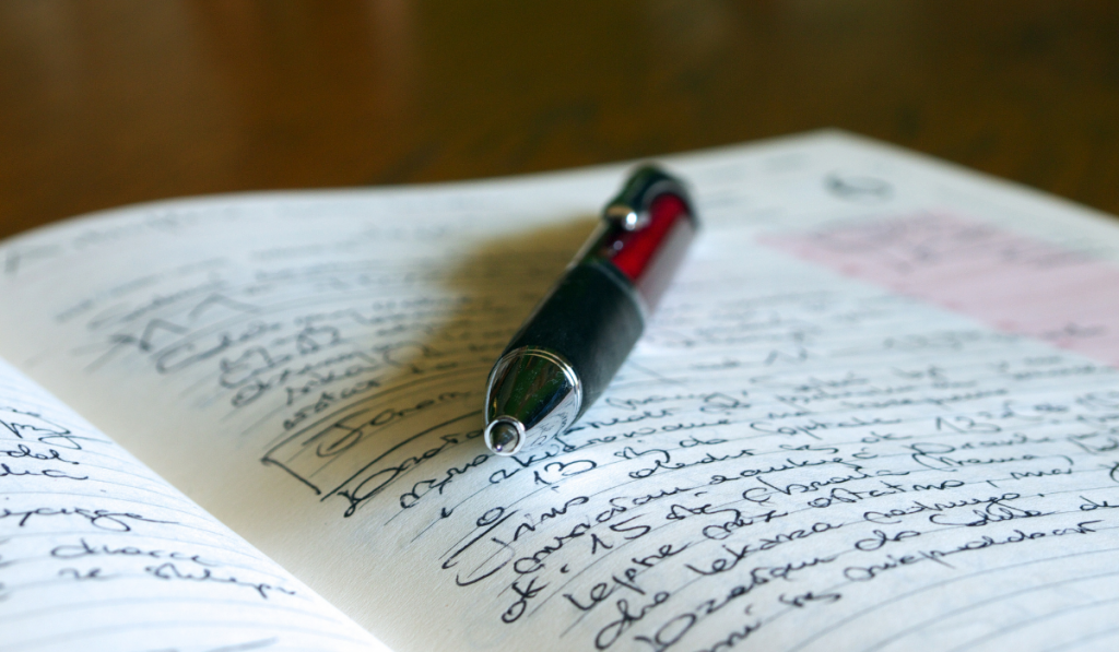 A notebook with writings on it