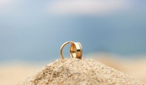 wedding rings on the sand