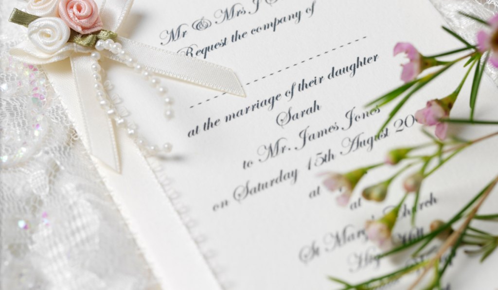 Pretty wedding invitation with flowers on the side.