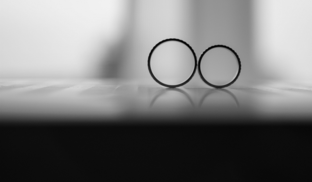Wedding ring band standing with a black and white filter.