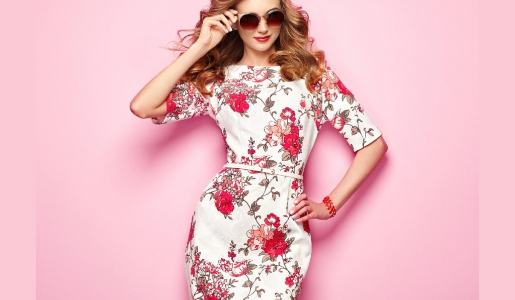blonde young woman in floral dress