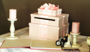 gift on a pink box for the bride and groom