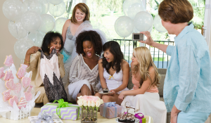 bride opening gifts on her bridal shower party