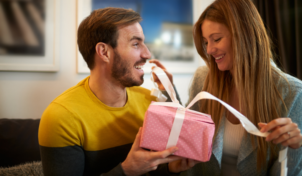 Couple opening the pink gift