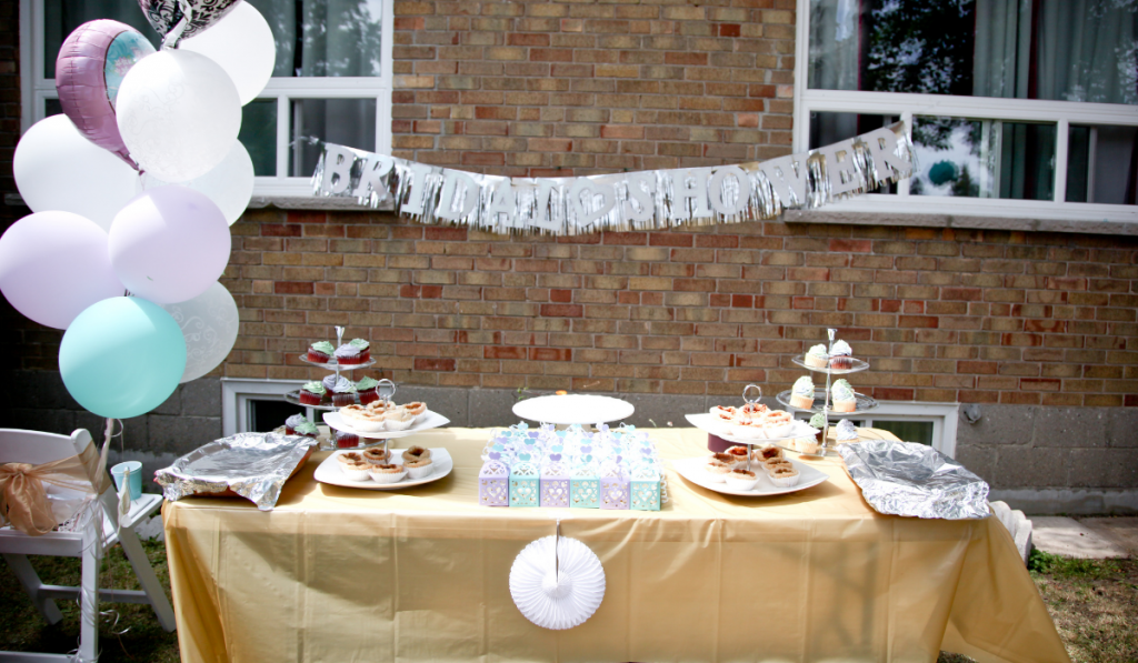 Dessert table of the event with balloons in the side